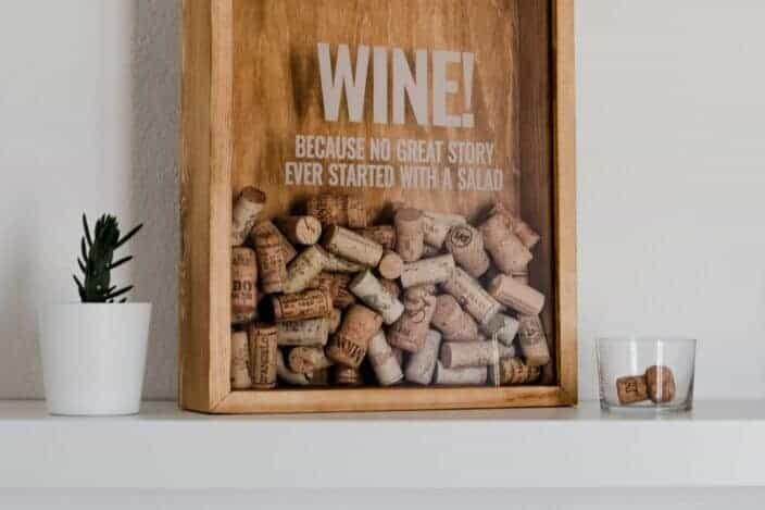 wine corks inside a frame