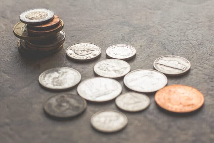 Assorted silver and gold colored coins on gray surface