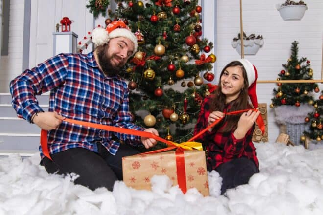 hard christmas trivia - lovely couple opening presents