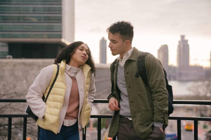 Hispanic couple talking on urban street