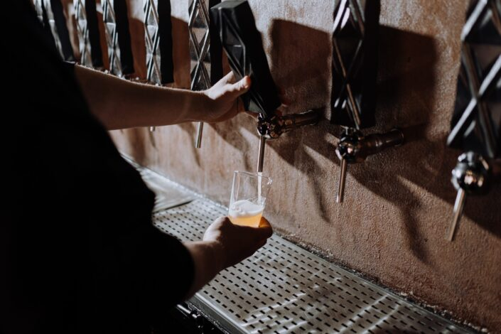 a man pouring beer