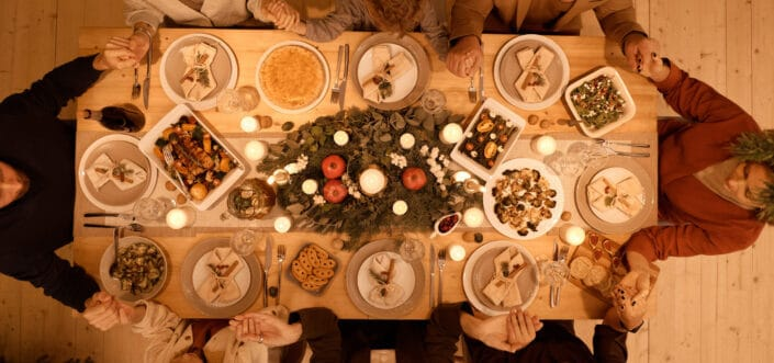 Top view of family praying before christmas