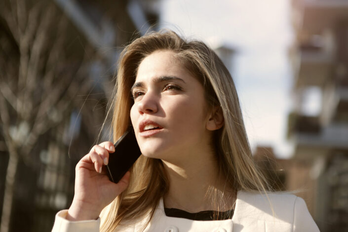A woman calling someone on the phone.