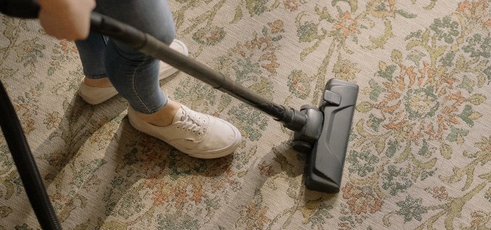 a carpet being cleaned by an electric cleaner