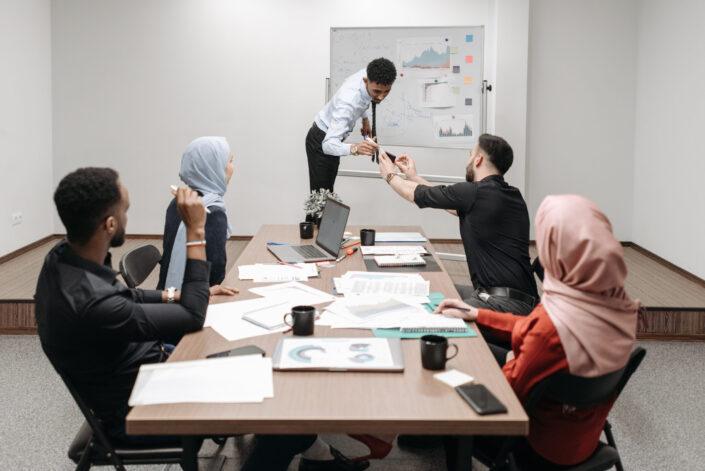 Employees having a presentation meeting.