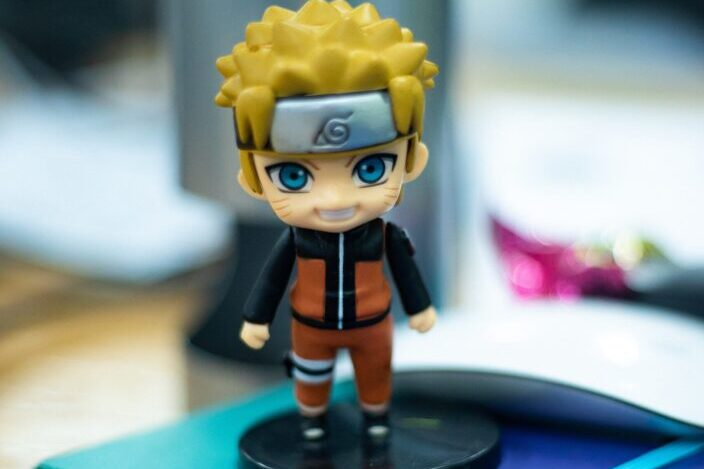 naruto figurine on top of notebook