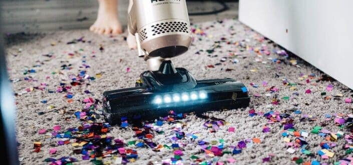 a sophisticated cleaner used to clean a carpet littered with confetti