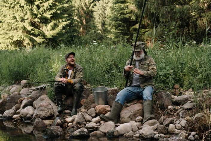 Middle-aged and older man fishing together