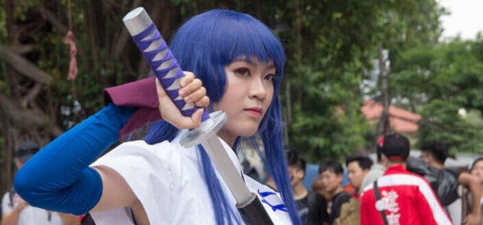 cosplayer woman holding sword