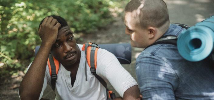 hiker comforting his friend