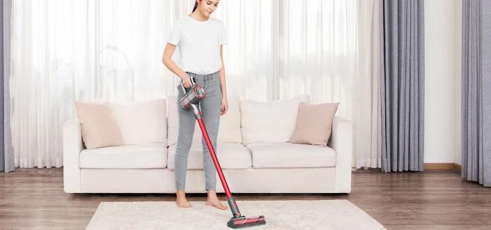 a woman vacuuming her carpet