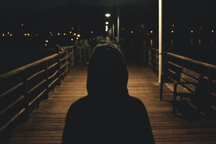 Woman walking alone at night.