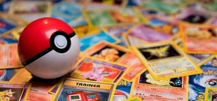 Pokeball Toy on a bunch of Pokemon Cards