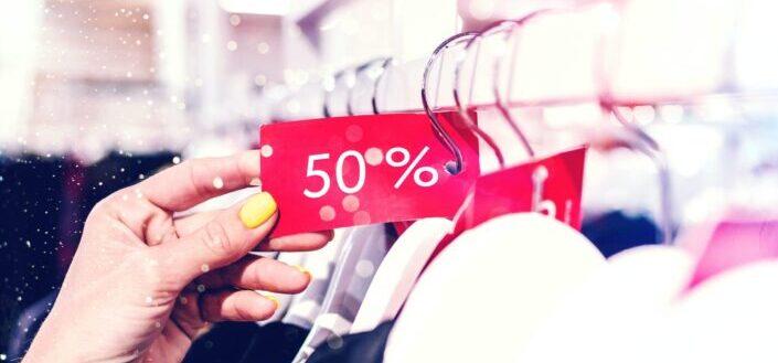 a 50% off tag on a dress display