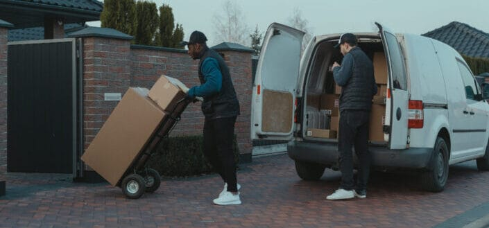 delivery man distributing parcel at the house