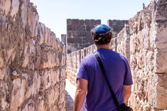 Man Walking along The Old City Of Jerusalem
