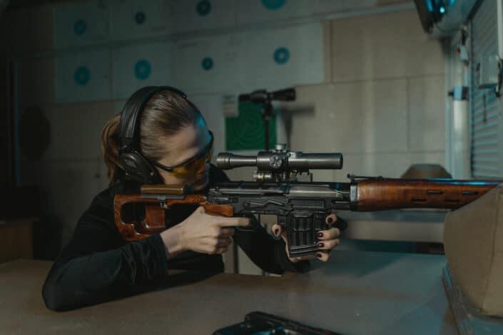 A woman shooting with a BB gun.