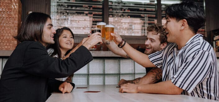 group of friends toasting their drinks cheerfully