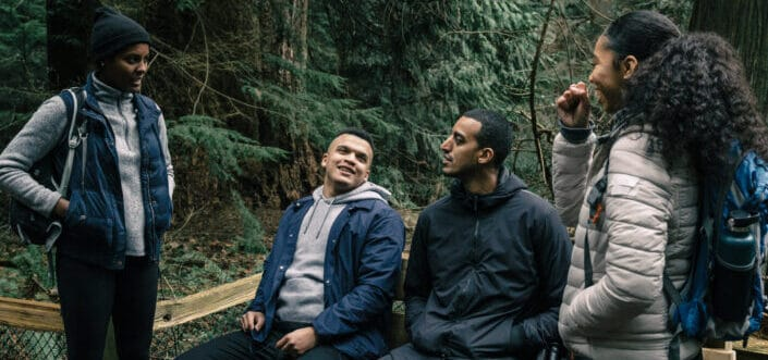 Friends talking while on a hiking break.