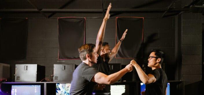 three guys doing something fun in an internet shop