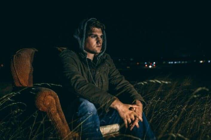 Man spending time alone at night outdoors.