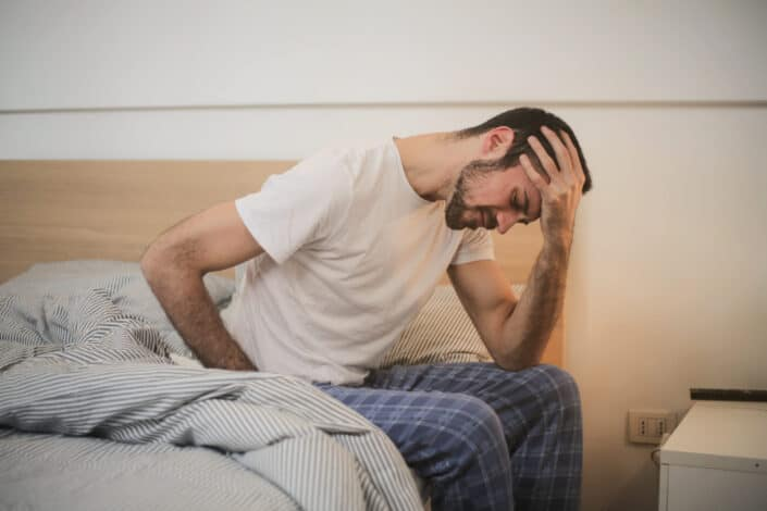 Man suffering from stomach ache.