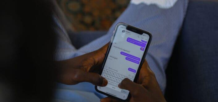 Man sitting while texting
