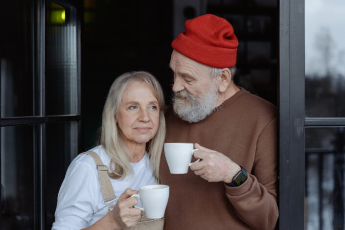 old couple drinking their coffee lovingly