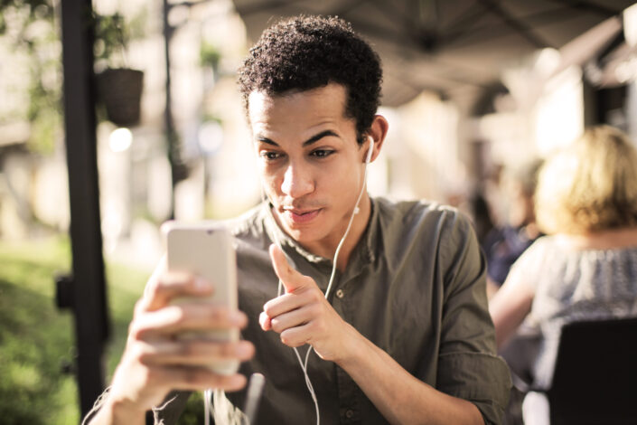 man video chatting with someone outside