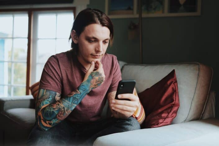 man looking at his cellphone