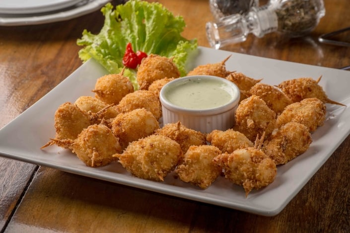 fried food with sauce and lettuce