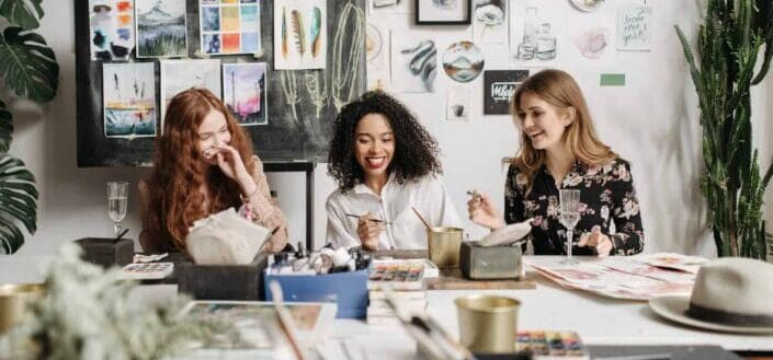 three woman at the painting class
