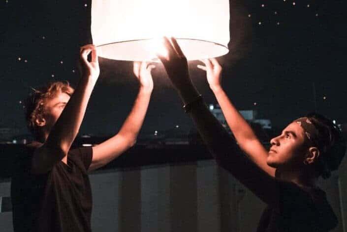 Friends preparing a sky lantern