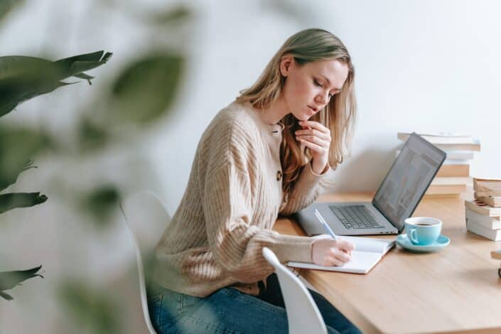 A busy woman working in front of her laptop