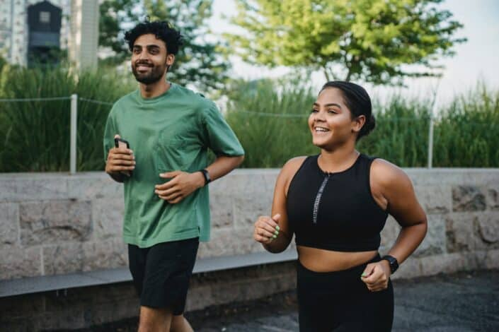 Man and a woman jogging on an exercise