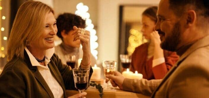 Man and a woman having conversation while drinking wine