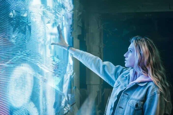 Girl reaching her hand through a portal
