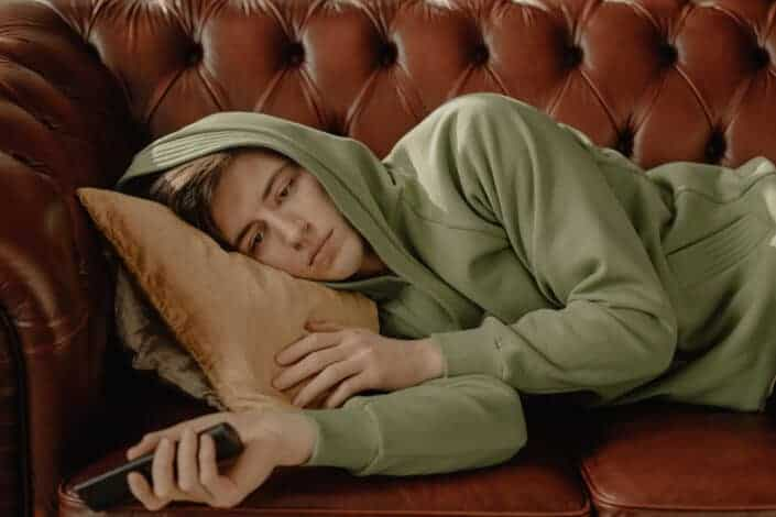 A guy lying on a couch