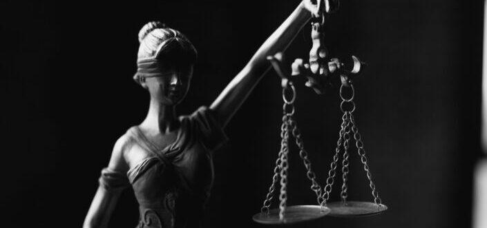 A miniature justice symbol statue.