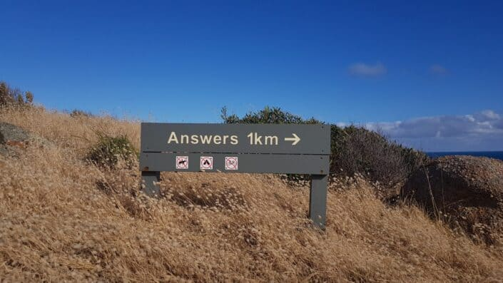 A signage pointing towards answers