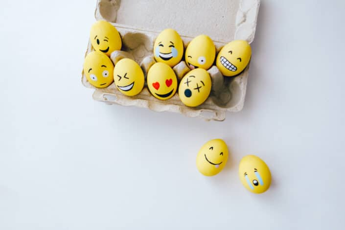 Different emoticons painted on eggs