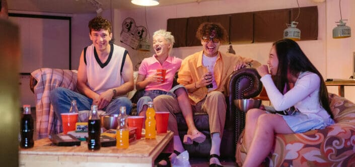 Friends laughing over drinks.