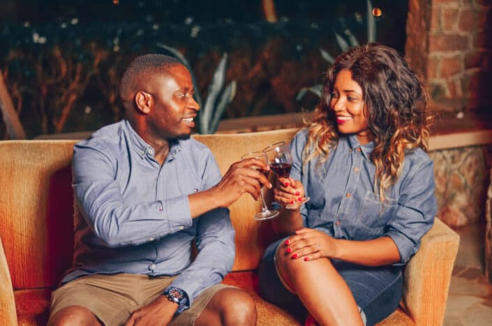 Man and woman drinking wine together.