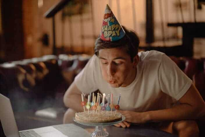 Man blowing his birthday candles