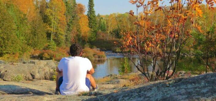 Man sitting beneath a river