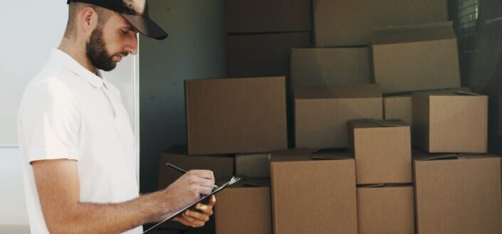 Man checking his list of delivery.