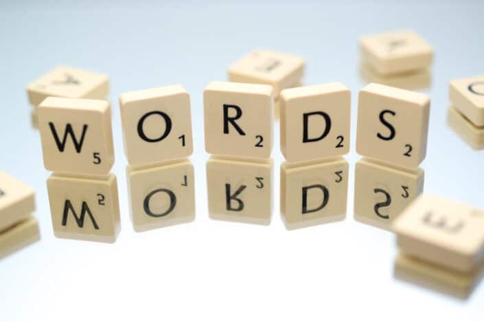 Scrabble letters arranged to spell WORDS.