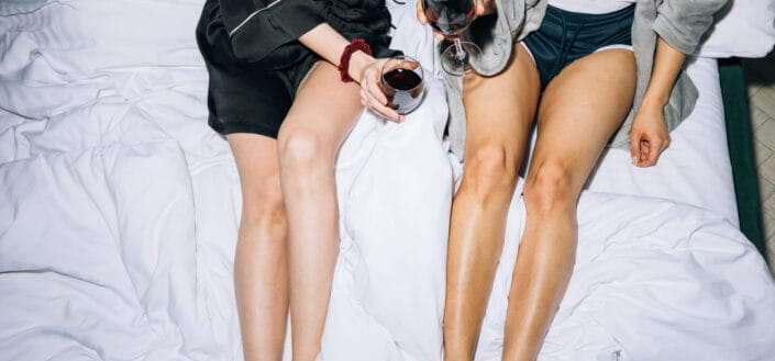 Friends Holding Wine Glass With Red Wine.