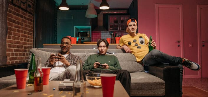 Men playing a game while having sleepover