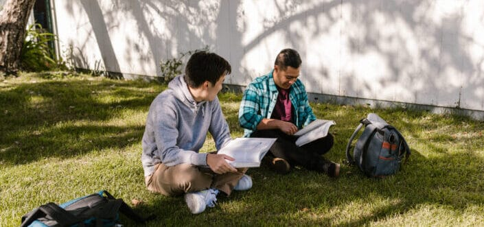 Men studying outdoors.